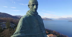 Aerial: Statue of San Carlo Borromeo in Aarona, Italy Stock Footage