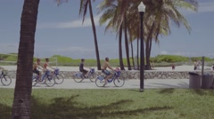 Tourists riding bike on Ocean Drive Stock Footage