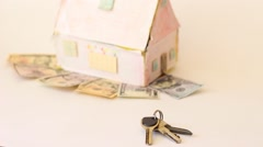 House Standing On Money Bills House Expenses Or Investing Concept Stock Footage
