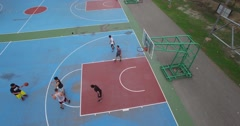 4k aerial left sweep of asian men playing basketball Stock Footage
