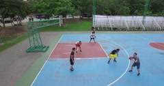 4k aerial zoom out- basketball- asian men attempting to score a basket Stock Footage