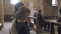 Family Mourning at funeral service in church Stock Footage