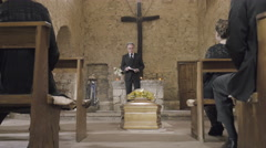 Speech and mourners at funeral service - stock footage