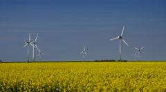 Wind turbine rape field Stock Footage