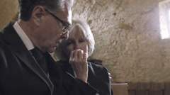 Senior Woman crying at a funeral - stock footage