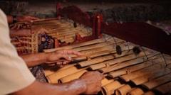 Two balinese man playing gambang at night - close up Stock Footage