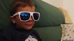 A little boy wearing sunglasses Stock Footage