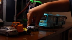 Boy playing toy cars Stock Footage