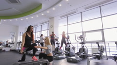 Pretty sportswoman does exercises on stepper in gym Stock Footage