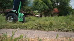 Close up wheels - Segway tour through Bali village in Pemuteran Stock Footage