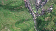 AERIAL HIGH ANGLE FLY OVER OF TIANTOUZHAI VILLAGE AND RICE TERRACES Stock Footage