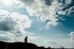 Couple lover holiday happy silhouette sky sunset - stock photo