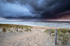 Showers rolling over north sea at sundown Stock Photos
