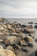 Rocky Shoreline over Ocean Stock Photos