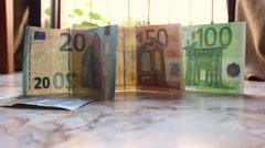 Money  on the floor and shake in the wind Stock Footage