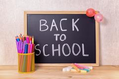 Education concept with text back to school is written in chalkboard, chalks,  Stock Photos