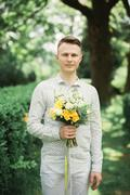 Man, groom posing with perfect wedding bouquet Stock Photos