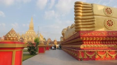 People praying at reclining buddha at That Luang,Vientiane,Laos - stock footage