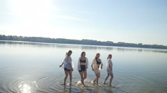 Dancing performance on water of four girls near beach Stock Footage
