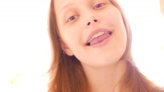 Teen girl having fun and taking selfies with funny faces, 4K UHD - stock footage