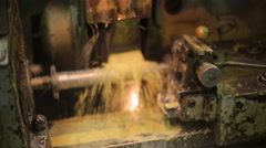 Process deep hole drilling on a lathe using a generous flow of coolant, rotating Stock Footage