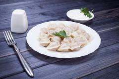 Hot meat dumplings on the table still life Stock Photos