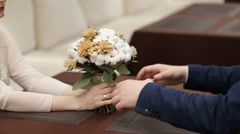 Hands of couple and wedding bouquet Stock Footage