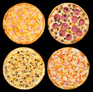 Four different pizzas, isolated Stock Photos