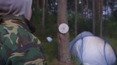 Man Playing Darts Throwing a Plastic Tip Dart in Camping Stock Footage