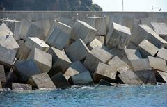 Breakwater of Blanes port with cubic armour units, Catalonia, Spain. Stock Photos