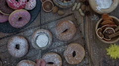 4k Donuts Composition on a Wooden Background with Sugar Powder Stock Footage