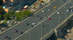 A wide road bridge, go over the bridge cars, top view Stock Footage