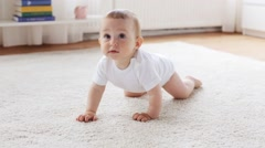 happy little baby crawling in living room at home - stock footage