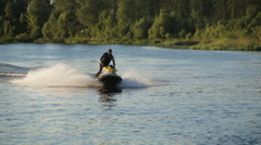 Man on jet ski in a river Stock Footage