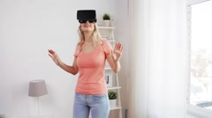 woman in virtual reality headset or 3d glasses - stock footage