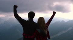 Overhead shot - Hiking couple raise arms Stock Footage