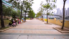 Walking along the block-stone bund of the Hong Kong bay. Stock Footage