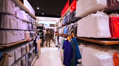 360 panoramic view of the shelves with clothes in Uniqlo store in Hong Kong mall Stock Footage