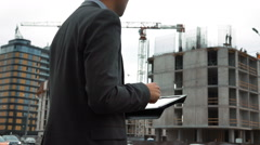 Architector check drawings on digital pad Stock Footage