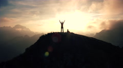 Aerial, edited - Silhouette of a man standing on top of the mountain Stock Footage
