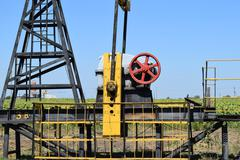 Pumping unit as the oil pump installed on a well Stock Photos