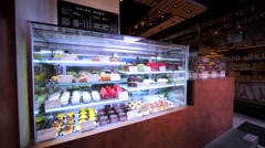 View of delicious sweet things and bread and flour products in Hong Kong bakery. Stock Footage