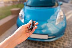 Hand of woman holding key for car - stock photo