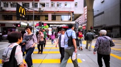 Crossing the road using the crosswalk. View of the McDonald's cafe. Stock Footage