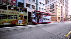Two-storeyed tramways standing one by one on the Hong Kong street. Stock Footage