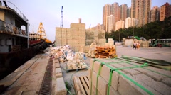 A lot of bricks on pallets on the Hong Kong mooring. Stock Footage