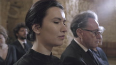 Woman mourning at funeral service in church - stock footage