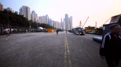 Walking along the block-stone bund and a Hong Kong mooring at the right. Stock Footage