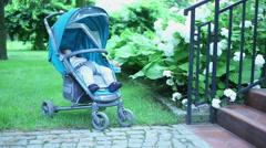 Cute Baby sleep in stroller on the garden  Stock Footage
