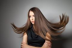 Beautiful model with smooth flying hair Stock Photos